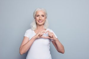 Woman forming a heart with her fingers
